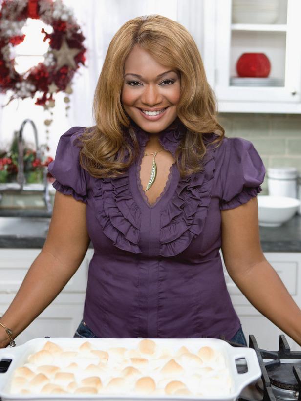 sunny anderson's wig poses with sunny anderson