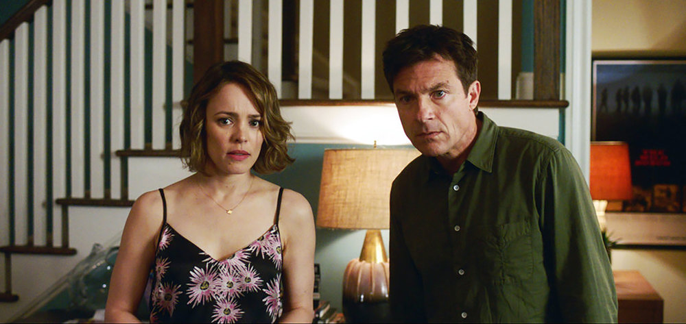 "This image released by Warner Bros. Entertainment shows Rachel McAdams, left, and Jason Bateman in a scene from ""Game Night."" (Warner Bros. Entertainment via AP)"