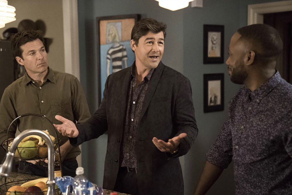 """This image released by Warner Bros. Entertainment shows Jason Bateman, from left, Kyle Chandler and Lamorne Morris in a scene from """"Game Night."""" (Hopper Stone/Warner Bros. Entertainment via AP)"""