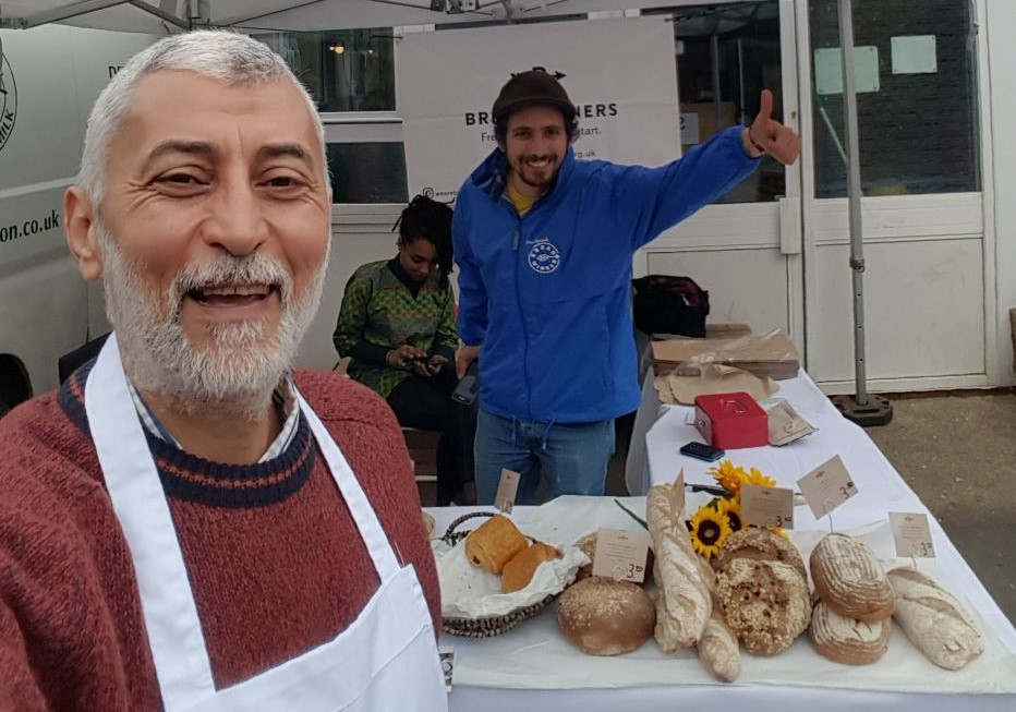 Ahmed and Martin selling bread.