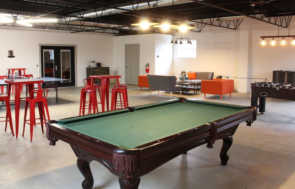 game room - All work and no play, right? Clear your head with a game of pool, settle a dispute over foosball, or challenge other members to a ping pong tournament.
