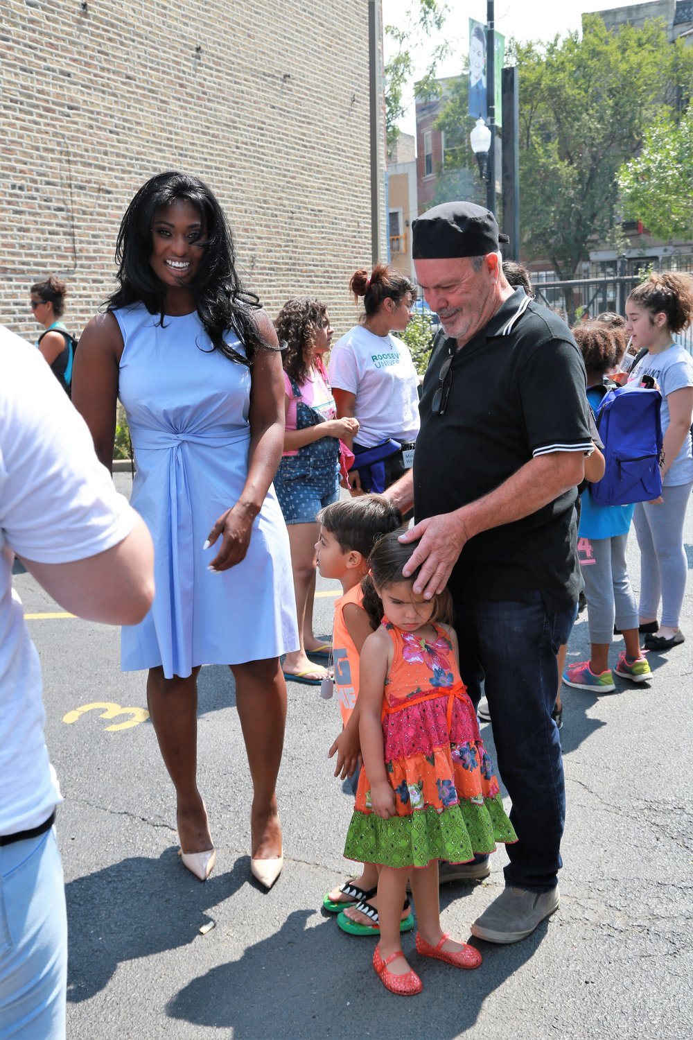 Theresa interacting with the community and neighborhood residents