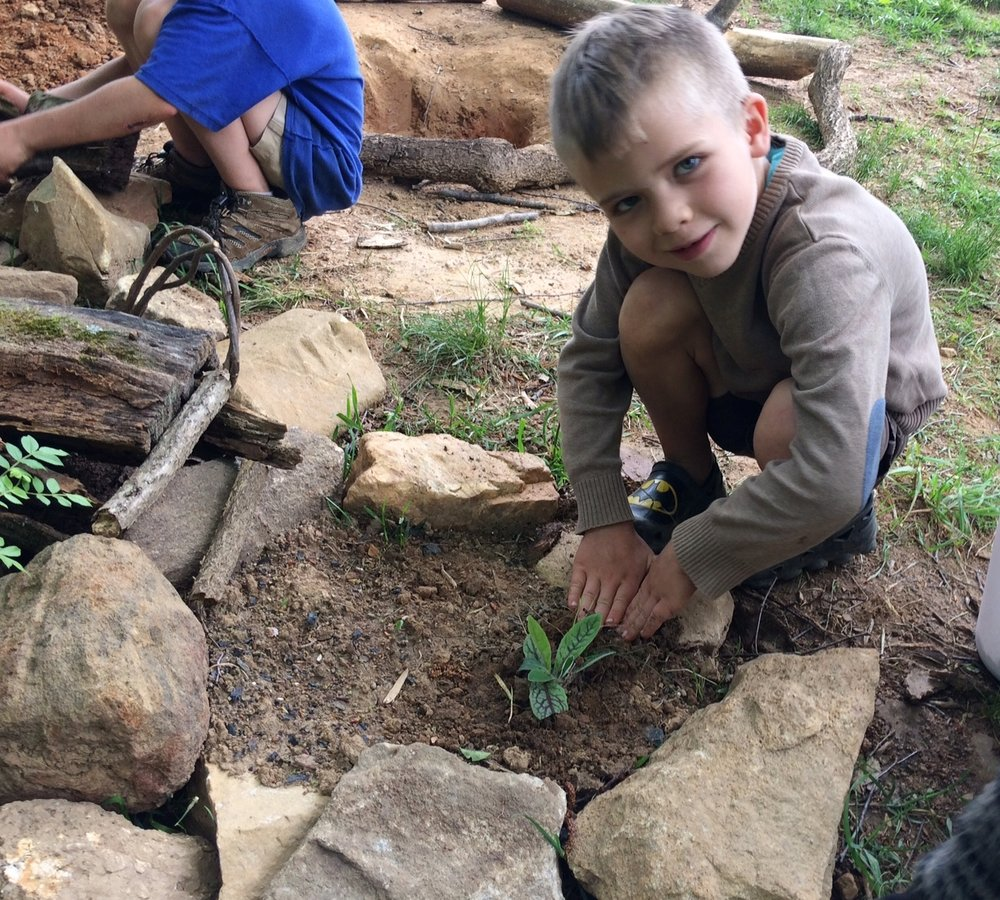 In the garden, the plants reflect to children that all things grow and thrive when cared for with loving hands.