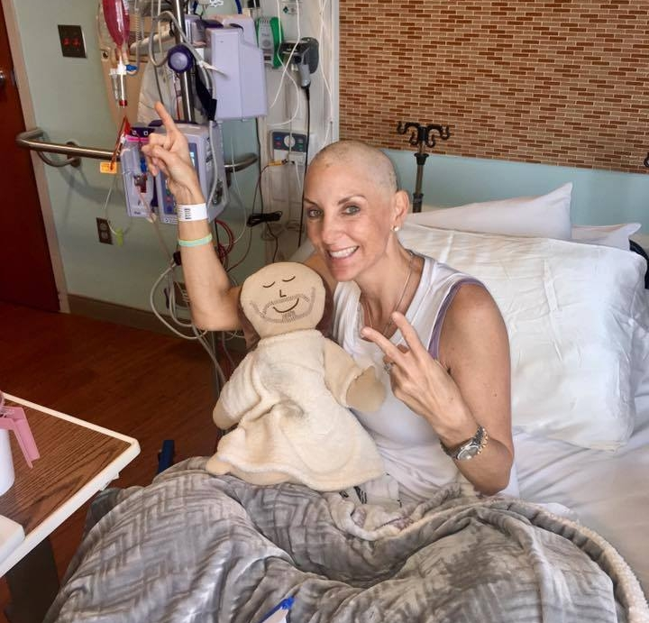 Cancer Comfort - Kathryn  is a beautiful mother, wife, sister, daughter and friend to many. She is a true Christian warrior who was diagnosed with Epithelioid Angiosarcoma in March 2017. She shared this picture as she wrapped up her final round of chemo. Her strength and positive attitude provides inspiration on how to live!