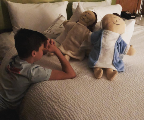 Night Time Prayers - Christl shared this photo after she stumbled across this sweet moment of her son during his nightly prayer.