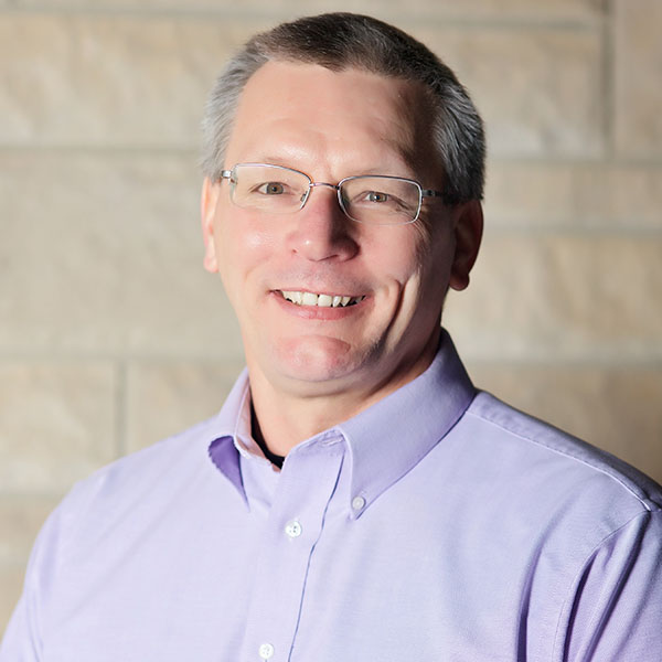 Mike McElyea - Executive Minister   Mike and his wife Sharon, came to Highland in the summer of 2009. They have two children (who for some reason both live near Canada), and a quint of gifted grandchildren. Mike is a graduate of Lincoln Christian and Illinois State Universities, and has served churches in Illinois and Iowa. Mike has also served as a college baseball coach, staff member and instructor; an avocation he continues as an adjunct faculty member at Lincoln Trail College. He believes an excess of coffee is good for you, watches way too much sports, and is an avid reader and Cardinal fan.