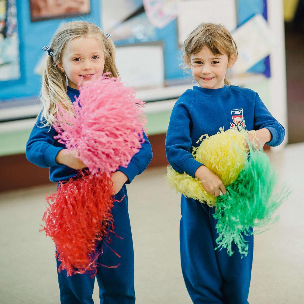 Hessle-Mount-Primary-girls-with-pom-poms.jpg