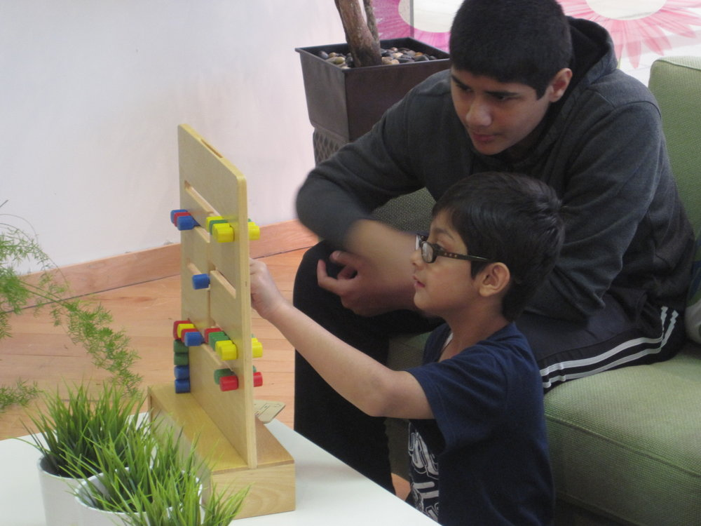 Working on a puzzle can be a great way to develop oral language skills. Here Musa shows his leader Fahim how it's done!