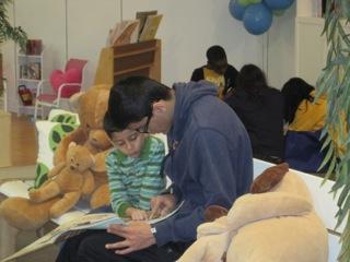Huzaifa enjoys showing off his reading skills to his leader Obaid.