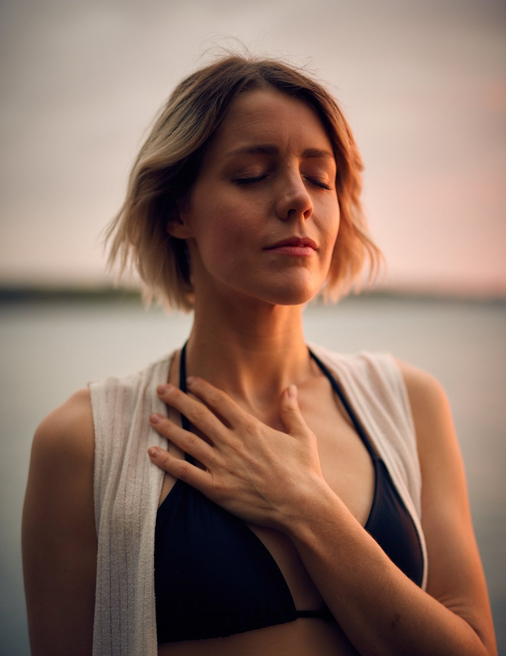Serious Illness and Caregiver. Breath Tool. Woman with her Hand on her heart.