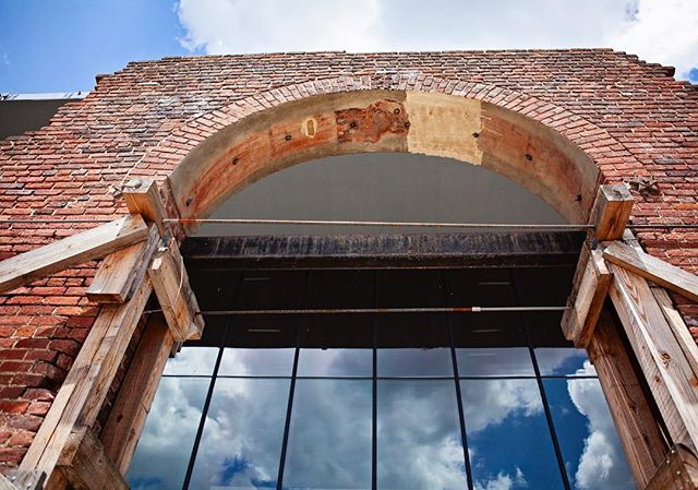 Such a cool shot of looking up at our iconic arch. In our new building, you'll walk through here to get to the front doors, ensuring one of the most iconic visuals of Tredegar remains. #richmondva #rvaphotography