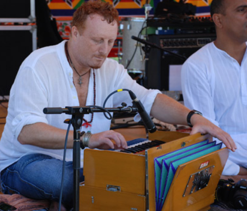 Mollura playing Indian Harmonium - Venice Music Festival.png