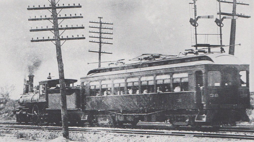 "For several months, the new electrified service operated only as far as Westport, where the train cars were coupled onto steam engines for the reminder of the trip to Baltimore. Circa 1900. Source: ""Every Hour On The Hour"" by John Merriken"