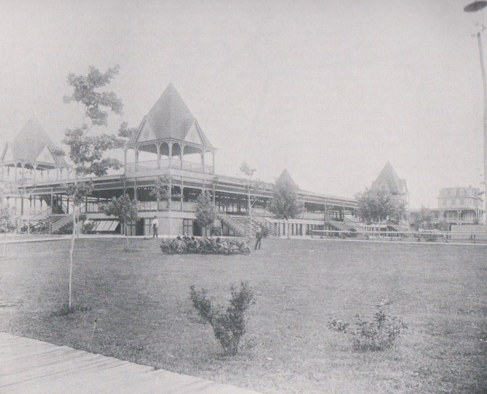 """The main pavilion restaurant, with a seating capacity of 1600, was reached by rows of wide wooden steps facing the waterfront. The Bay Ridge Hotel is seen in the background"". Date: Unknown. Source: Forbes Collection."