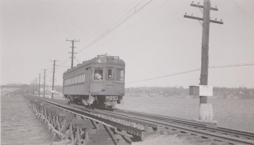 Baltimore & Annapolis Railroad Car #102 crosses the Severn River Bridge heading South towards Annapolis. Annapolis, Maryland Date: 1949. Source: Hugh Hayes Collection.