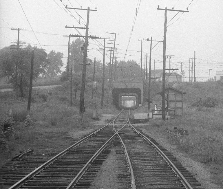 Baltimore & Annapolis Railroad Car traveling by Westport Station just south of Baltimore. Baltimore, Maryland. Date: Circa 1940's. Source: Hugh Hayes Collection.