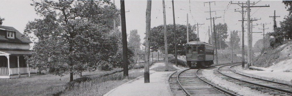 "Top: Baltimore & Annapolis Car #92 approaches Shipley Station heading North. Bottom: Baltimore & Annapolis Car #204 approaches Shipley Station heading South. Shipley Station, Maryland Date: May 1936. Source: J.P. Shuman Photo. from ""Baltimore Light Rail, Then & Now"" by Herbert H. Harwood Jr."