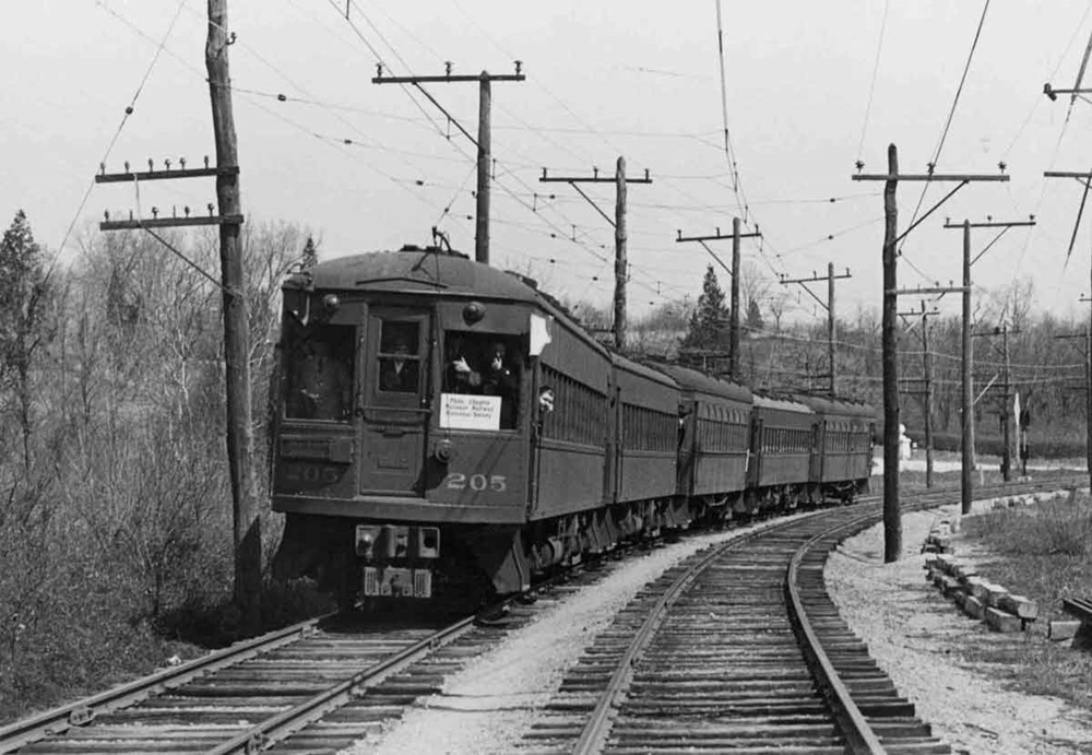 Railfans fill the five cars of a Philadelphia Chapter, NRHS, excursion on the Baltimore & Annapolis Railroad. The train is southbound between Baltimore and Linthicum Jct. Date: April 7th, 1940. Source: William M. Moedinger Collection.