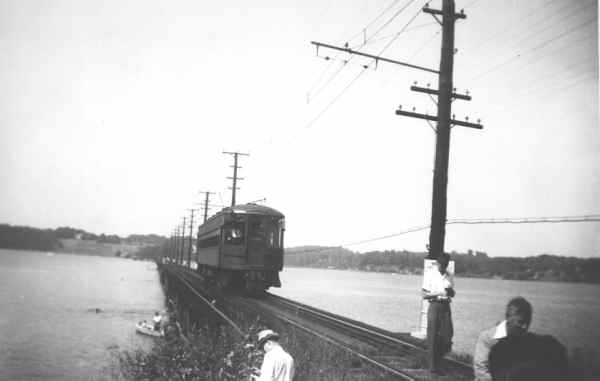 Baltimore & Annapolis Railroad Car traveling over the Severn River Bridge. Date: Unknown. Source: Unknown.