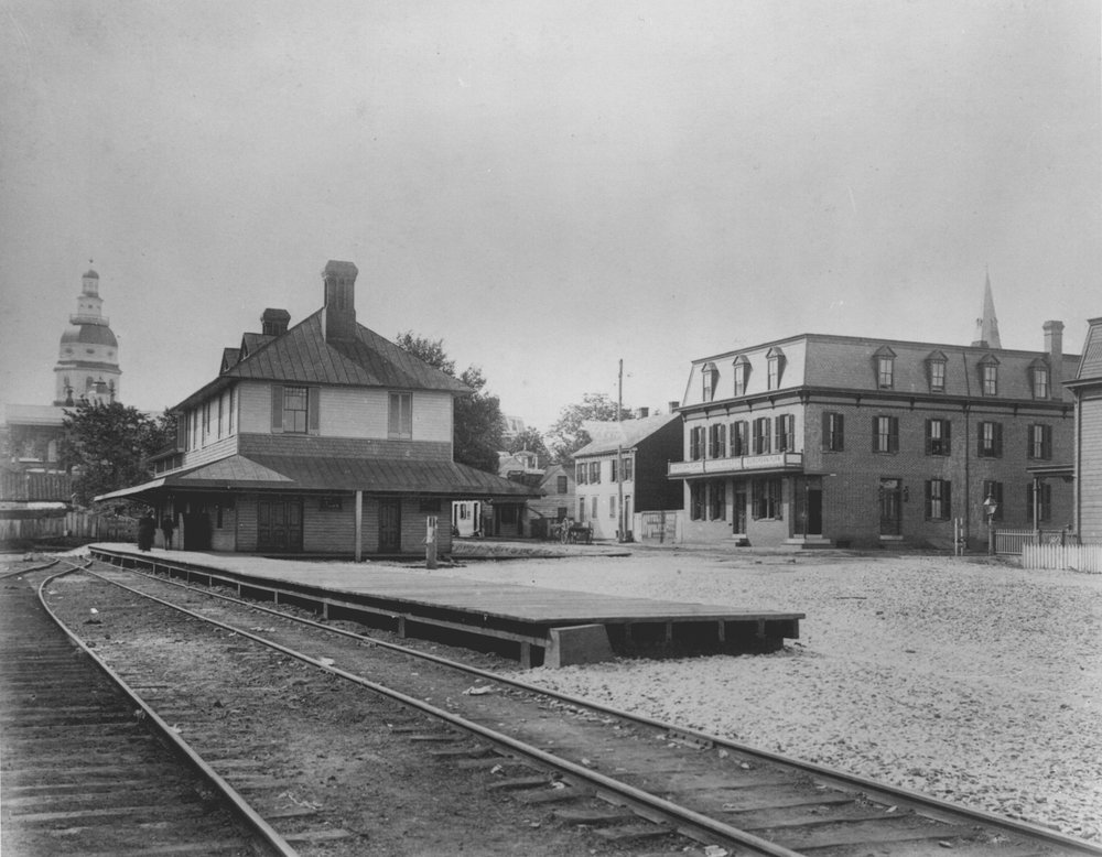 Bladen Street Station, The dome of the Maryland State House can be seen in the left corner. Across the street, to the right, on the corner, is Hotel Wolfes. Annapolis, Maryland. Circa 1900. Source: Maryland State Archives.