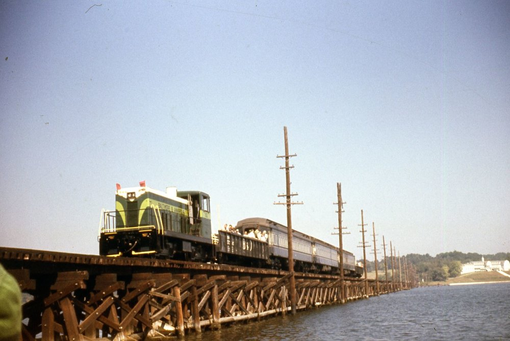 Baltimore & Annapolis Railroad #50 leads a special excursion over the Severn River Bridge. Date: 9/24/1961. Source: Robert Riley, Maryland Rail Heritage Library Collection.