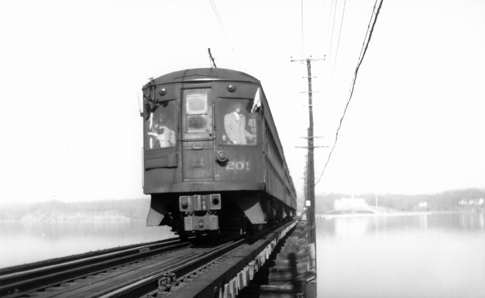 Baltimore & Annapolis Railroad Car #201 crossing the Severn River Bridge. Annapolis, Maryland Date: January 22, 1950. Source: Railroad Avenue Enterprises.
