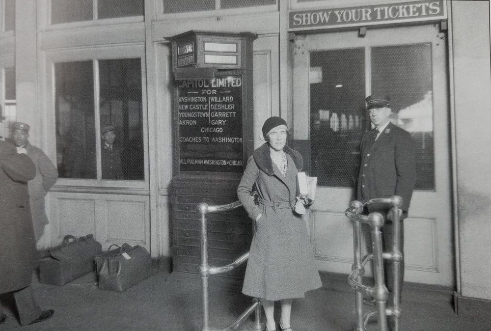 "A passenger waits to board at Camden Station in the 1920's, most likely she will be riding the Baltimore & Ohio's ""Capital Limited"" which travels from D.C. to Chicago. Date: 1920's. Source: Unknown."