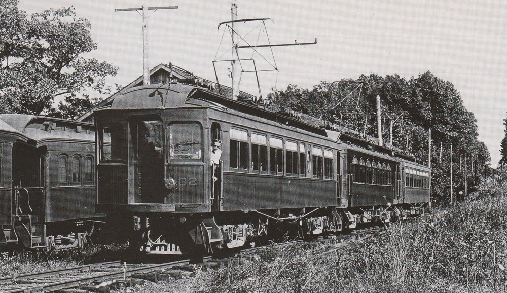 """Heavy wood equipment like this inaugurated the Annapolis Short Line electric service.. The two end cars of this three-car train came from the Southern Car Company in 1908.; they were later sold to the WB&A which rebuilt them into frieght motors in 1917. in the center is a 1909 Jewett-built combine."" Date: Unknown. Source: George Krambles Collection,  Baltimore Light Rail, Then and Now ."