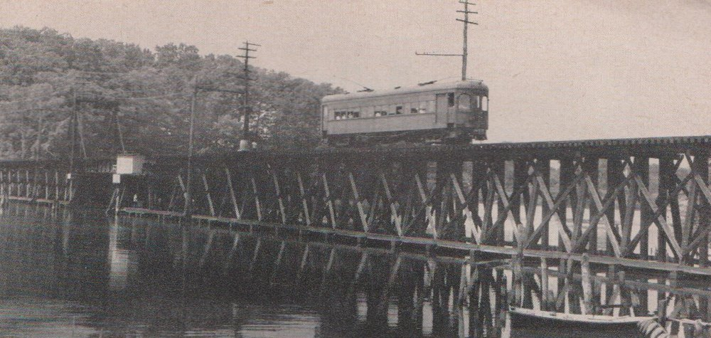 Baltimore & Annapolis Railroad Car traveling over the College Creek Bridge into Bladen Street Station. Annapolis, Maryland Date: Unknown. Source: William D. Middleton Collection.