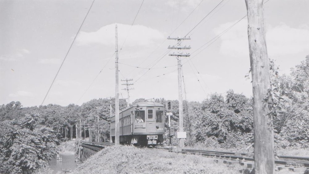Baltimore & Annapolis Railroad Car traveling over the College Creek Bridge into Bladen Street Station. Annapolis, Maryland Date: Unknown. Source: Hugh Hayes Collection.