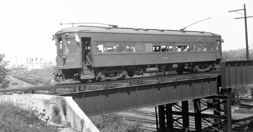 Baltimore & Annapolis Railroad Car #205 northbound over the entry to Port Covington in South Baltimore. Baltimore, Maryland Date: April 1947. Source: Lee Rogers Collection.