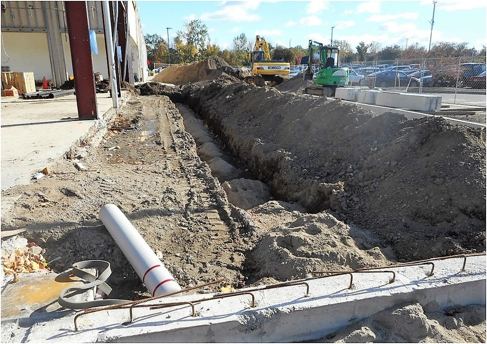 10-18 excavate for new floor drains at new drive lane.jpg