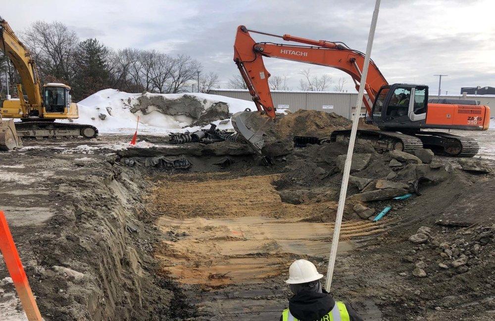 1-24 Excavating for rear retain it basin system.jpg