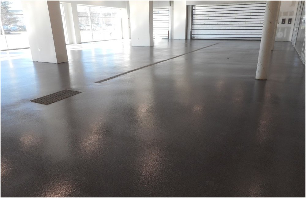 3-28-19 Complete Epoxy Floor at Drive Lane and Alignment Pits.jpg