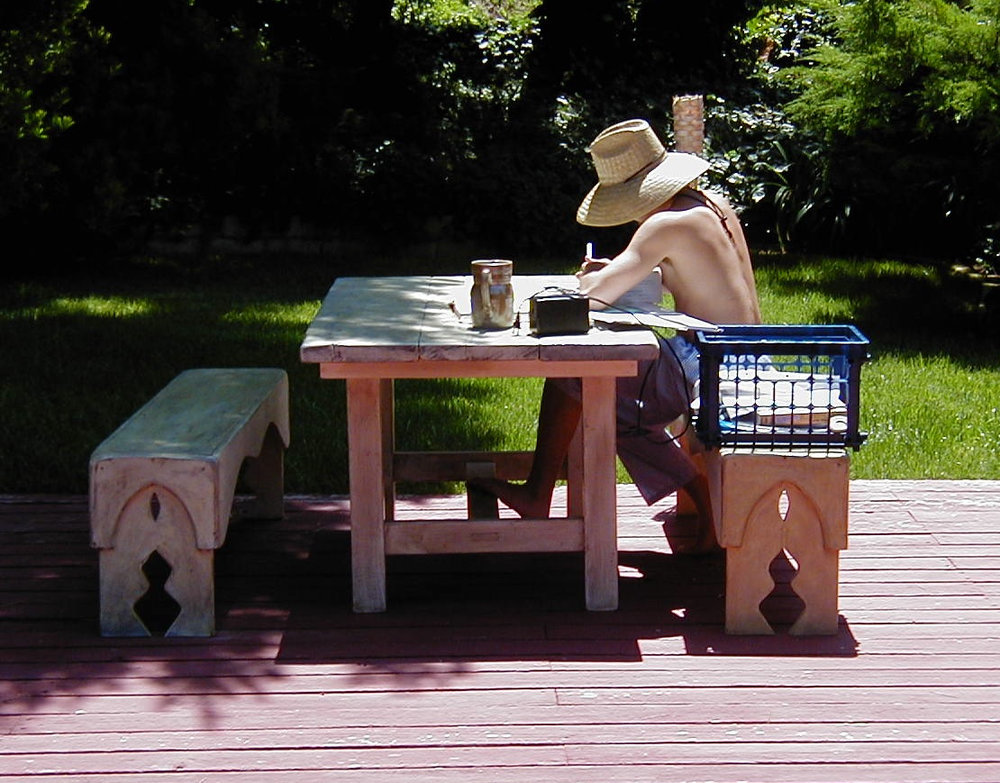 Outdoor Rustic Table and Benches (pic) Christopher, Stephen's then teenage son doing his homework under the Malibu sun.