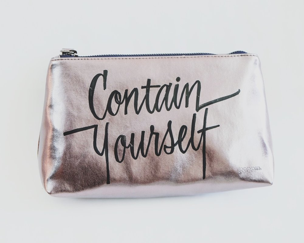 """Contain Yourself"" - Hand-lettering customization in collaboration with Poppin and The Container Store Tool: Decocolor marker in BlackSubstrate: Poppin metallic pouch in silver"