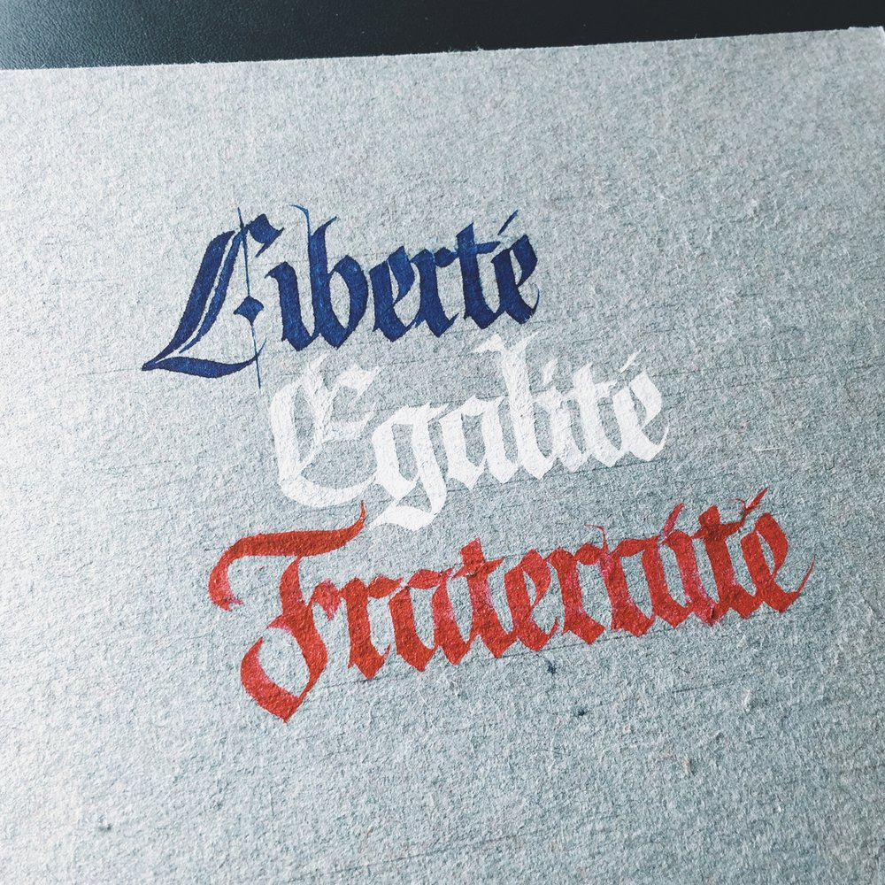 LIBERTÉ EGALITÉ FRATERNITÉ - Fraktur blackletter Tools: Mitchell nibInk: Blue, white and red gouacheSubstrate: St. Armand Canal paper