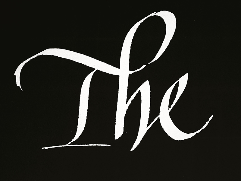 """Italic """"The"""" - with a Th ligature. Hand-calligraphed and then inverted digitally into white on black.Tool: Speedball C nibInk: Pilot Drawing inkSubstrate: Gilbert bond paper"""