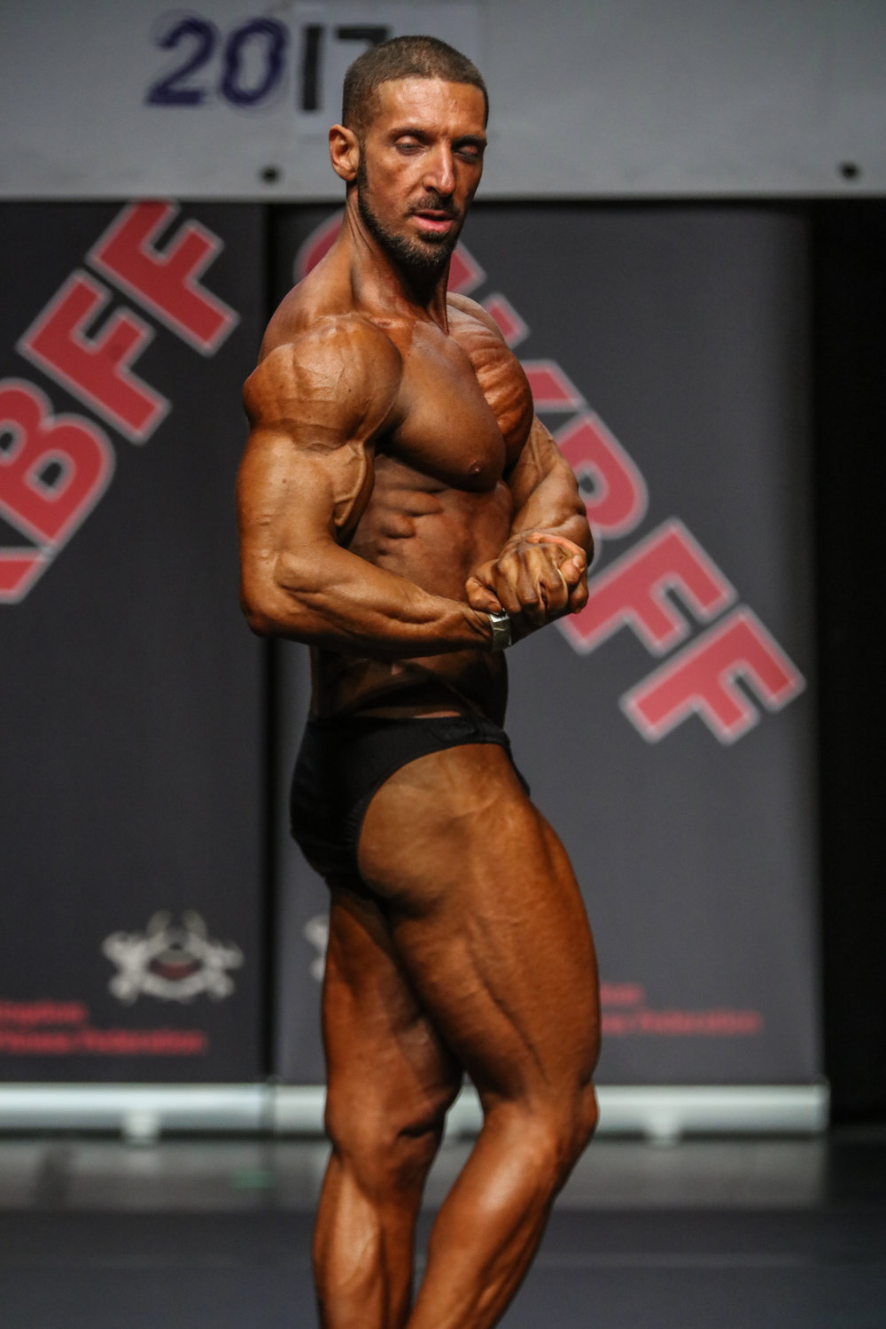 Emi Roberti displays an impressive side chest on his way to victory at last year's UK Nationals. PHOTO: Christopher Bailey