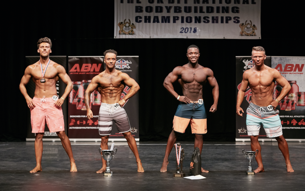 Isaac Francis (second from right) wins junior men's physique. PHOTO: Christopher Bailey