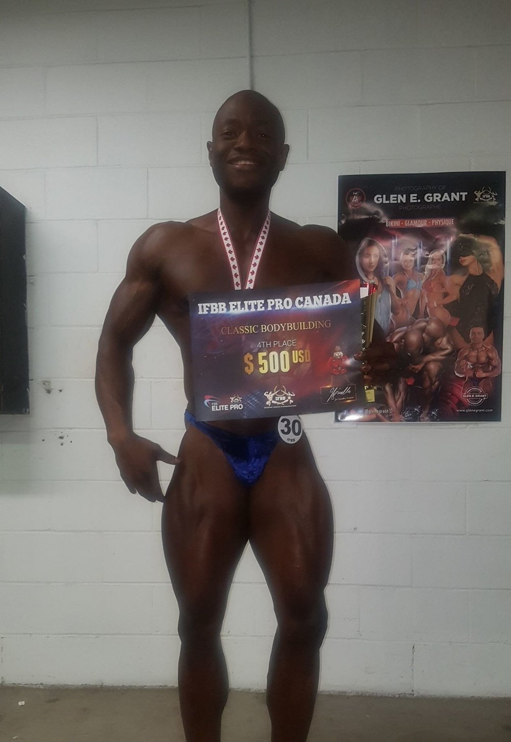 Reno holds his cheque in Canada.