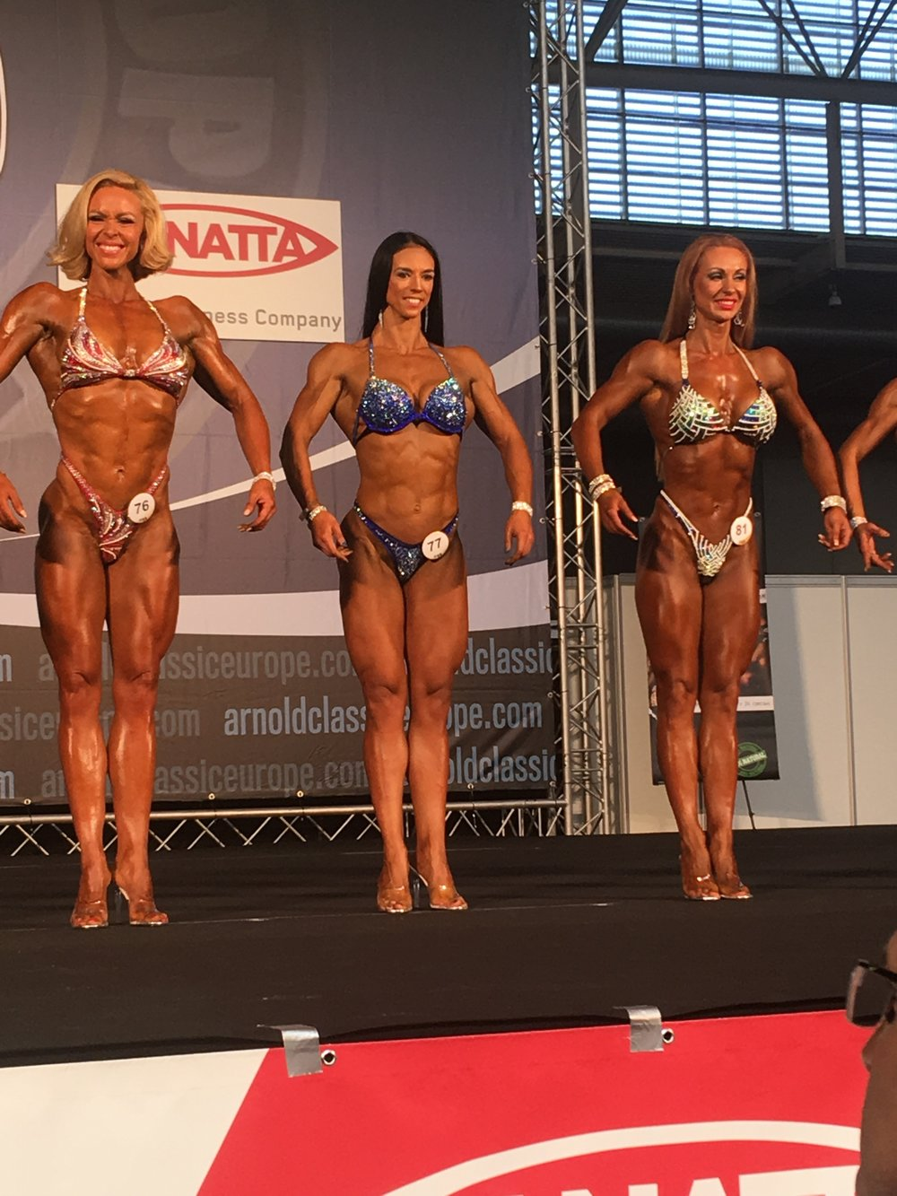 Olga Upelniece (centre) has made the top six in a 20-strong masters bodyfitness line-up.