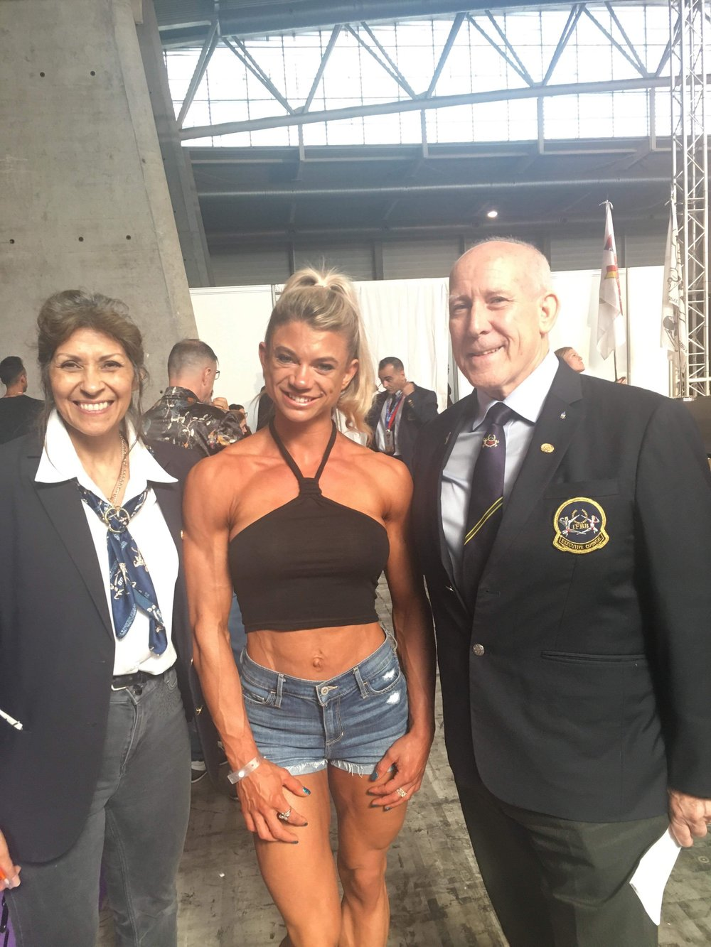 Silver medallist Kristie Sanderson with Bill and Wanda Tierney of the UKBFF.