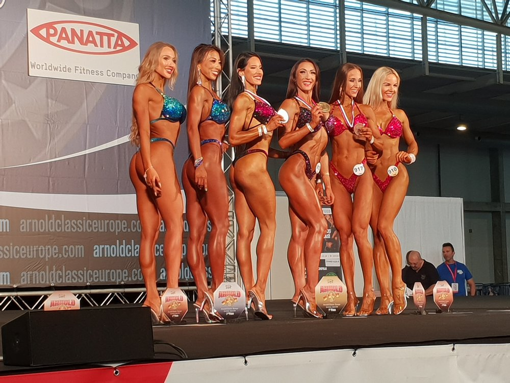 Marta Mila displays her silver medal.