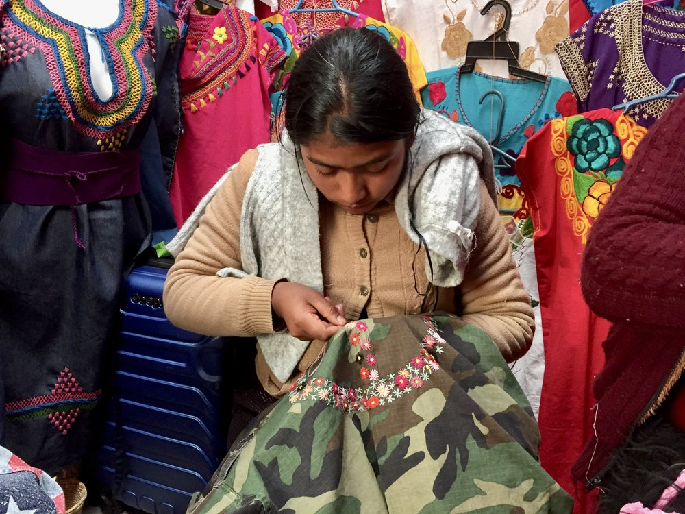Susana redesigning the Military Peace jacket.