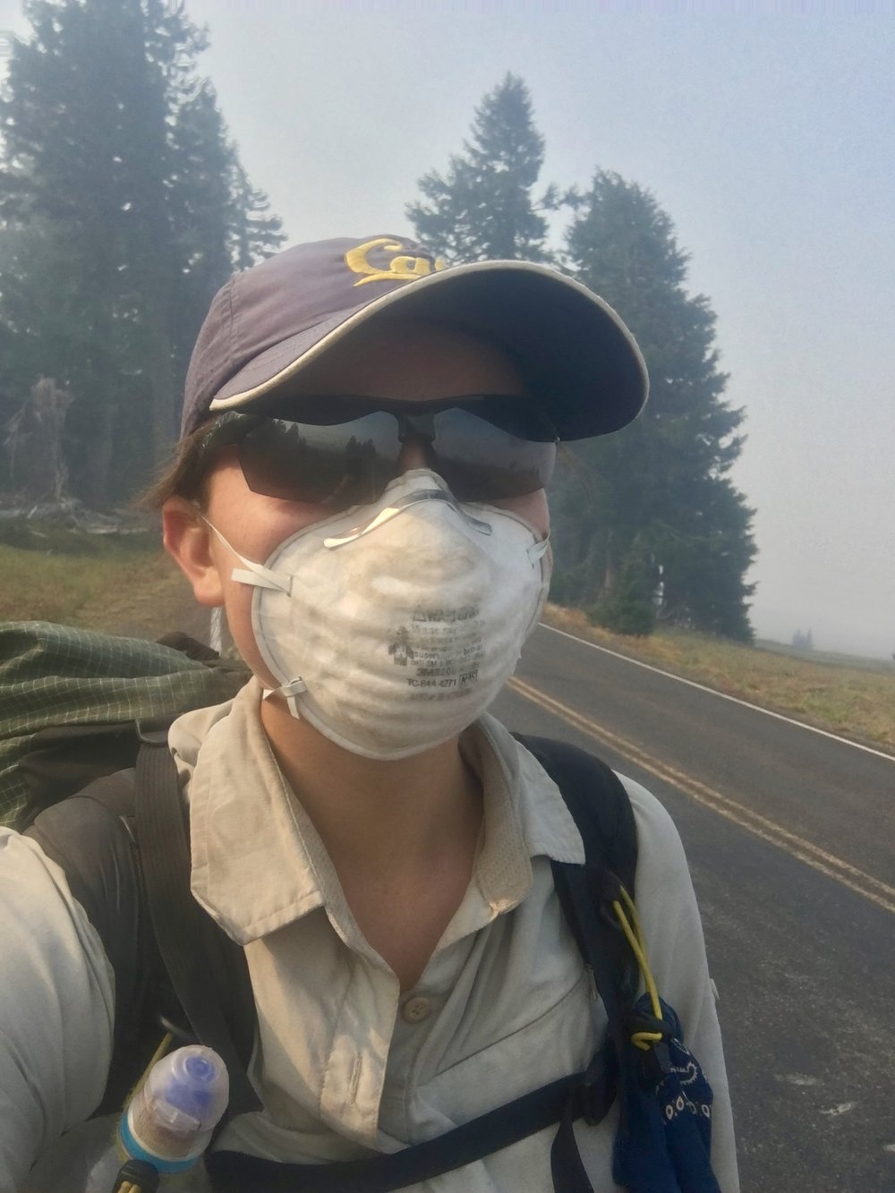 Road walking around Crater Lake with a smoke mask. We didn't get to see the lake that day because the bowl was completely filled with smoke from nearby wildfires.