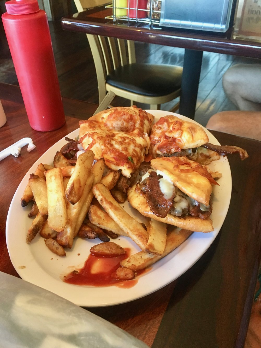 "This is the ""hiker trash burger"" found in Cascade Locks, OR. It is a bacon cheeseburger with personal pepperoni pizzas in place of buns and a side of fries."