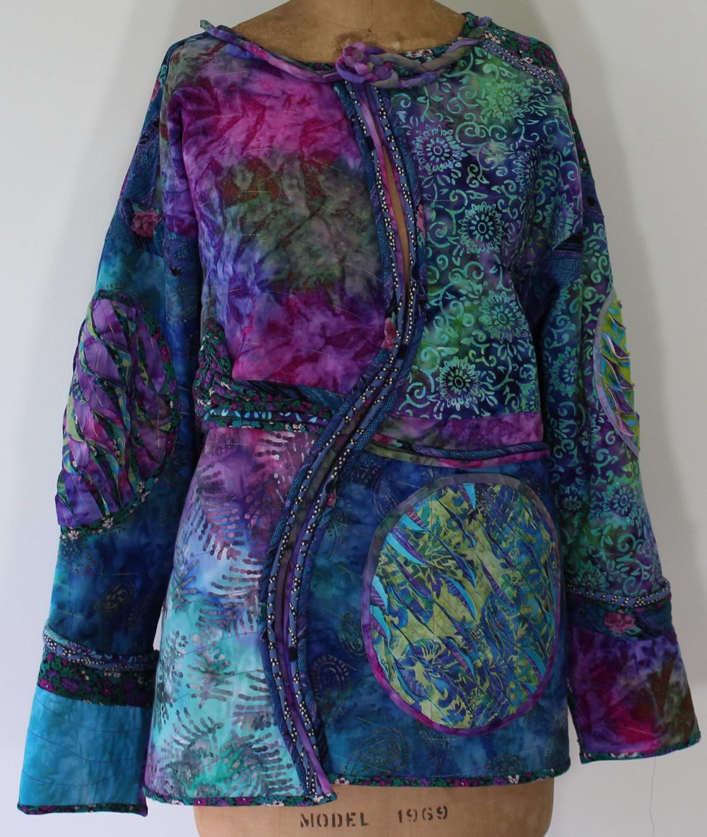 Wearable Art - Fantasy Fiber Art features hand-dyed garments and accessories and fabric jewelry. Wearable art jackets created from sweatshirts have won awards in national competitions. These colorful and vibrant works of art are embellished with fabric manipulation, piping, button knots, and lace.
