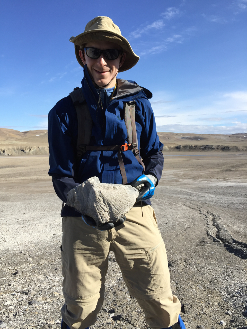 Holding a  shattercone  while exploring the  Haughton Impact Structure , Devon Island, Nunavut, Canada in July 2016.