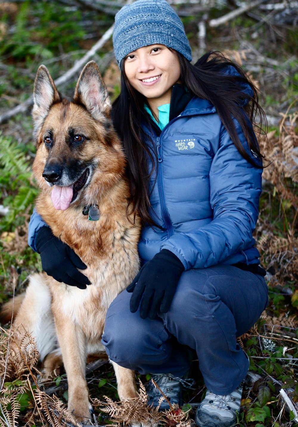 Anchor and Pine Collective Founder, Helen Schuckers and one of her dogs, Sadie in the Tillamook State Forest, Oregon. Photo credit  Kelley Johnson .